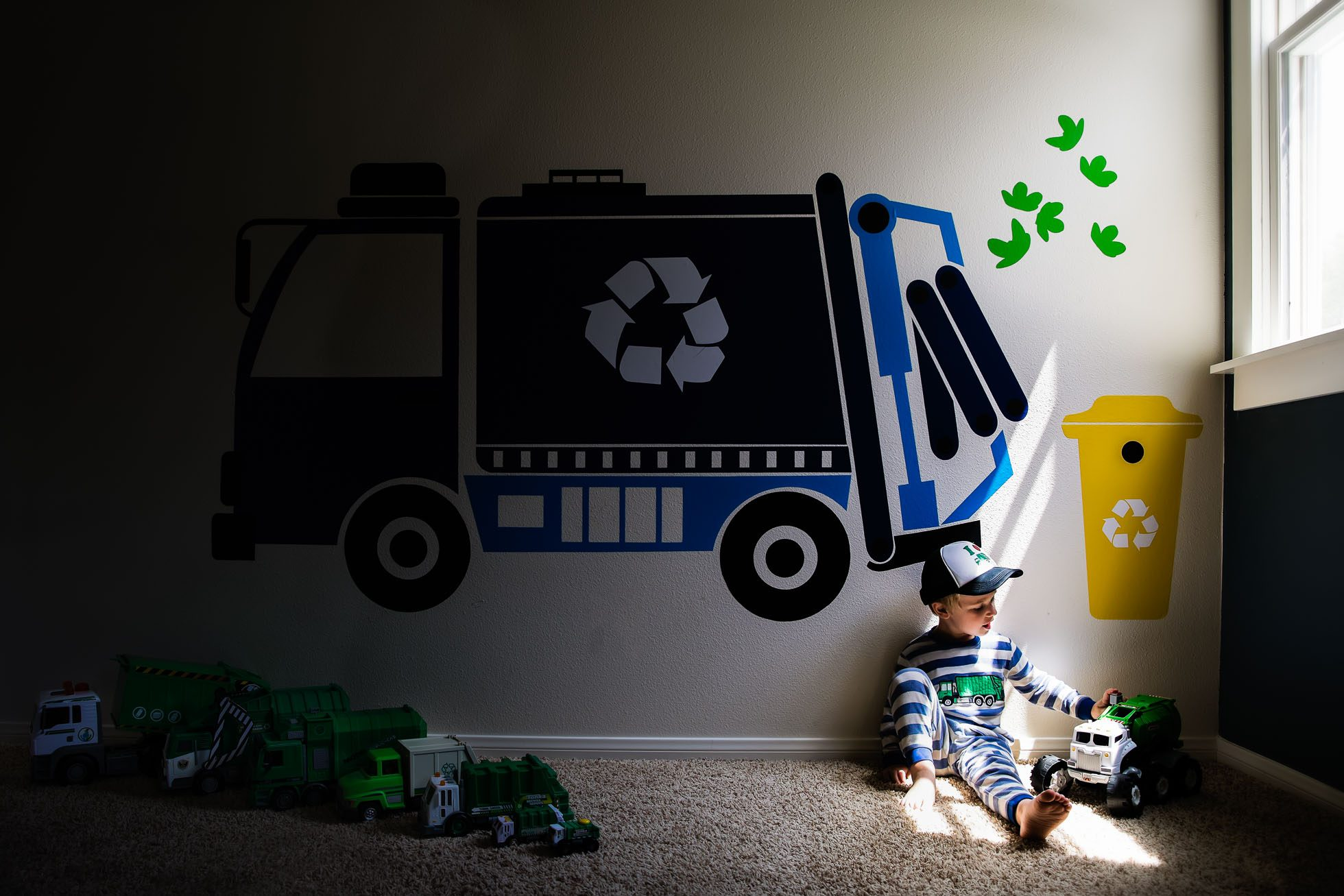 boy and garbage trucks