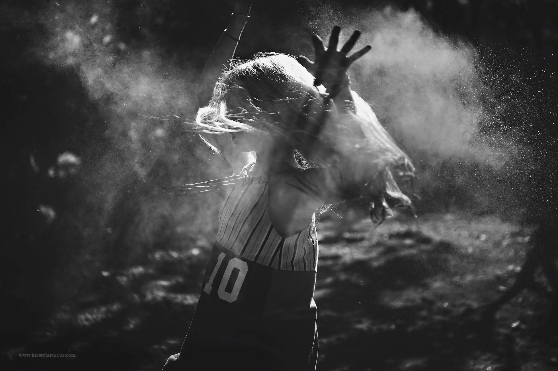 Black and white of a girl spinning in dust | by Kirsty Larmour, Lifestyle Photography