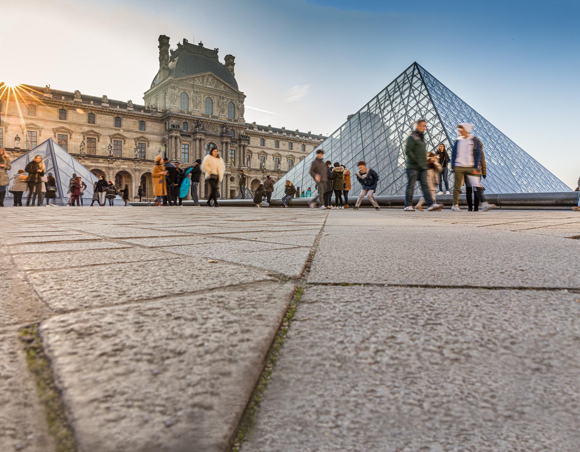 Early morning at the Louvre in Paris with my family all in the frame.
